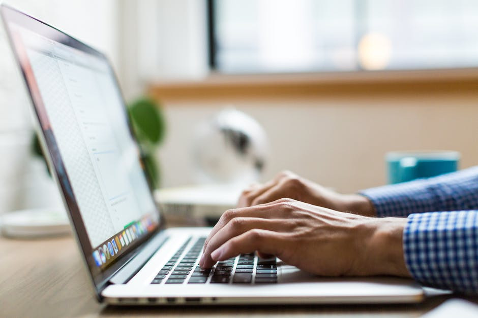 typing-an-article-on-a-laptop